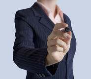 Business woman standing with marker in hand Royalty Free Stock Photos