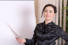 Business woman standing near the whiteboard. Royalty Free Stock Images