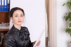 Business woman standing near the whiteboard. Royalty Free Stock Photography