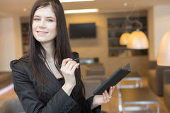 Business woman standing with a notepad Stock Photos