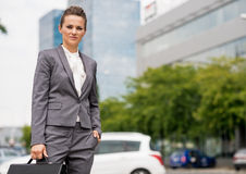 Business woman standing in office district Royalty Free Stock Photos