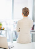 Business woman standing in office. rear view Royalty Free Stock Images