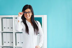 Business woman standing in office Royalty Free Stock Photos