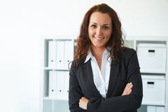 Business woman standing in office Stock Photography