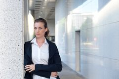 Business woman standing outside with arms crossed Stock Photo