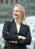 Business woman standing outside the office with arms crossed Stock Photos