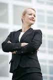 Business woman standing outside office building with arms crossed Royalty Free Stock Photo