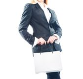 Business woman standing with paper bag isolated on white Royalty Free Stock Photography