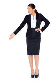 Business woman standing and pointing at copy space Royalty Free Stock Photos
