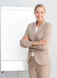 Business woman standing at a presentation board Royalty Free Stock Image
