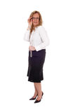 Business woman standing smiling.. Stock Photo
