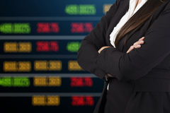 Business woman standing with stock market Royalty Free Stock Photos