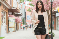 Business woman standing on the street Stock Photography