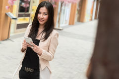 Business woman standing on the street Stock Photo