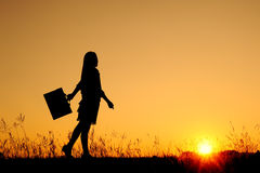 Business woman standing and sunset silhouette Royalty Free Stock Photos
