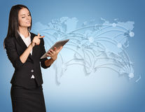 Business woman standing with tablet in hand on Royalty Free Stock Photo