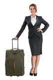 Business woman standing with travel suitcase Stock Images