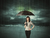 Business woman standing with umbrella data protection concept. On background Royalty Free Stock Image