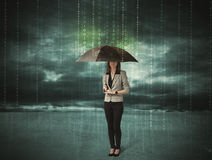 Business woman standing with umbrella data protection concept Stock Image