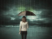 Business woman standing with umbrella data protection concept. On background Royalty Free Stock Photo