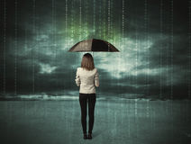 Business woman standing with umbrella data protection concept Stock Photo
