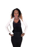 Business woman standing in white jacket. Stock Image