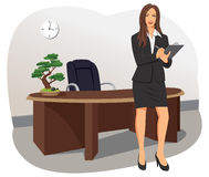 A business woman stands with a clipboard Stock Photos
