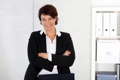 Business woman stands at her desk Royalty Free Stock Photo