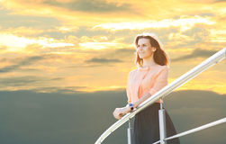 Business woman stands near railing Royalty Free Stock Photography
