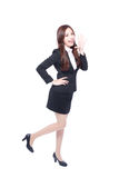Business woman stands shouting Stock Photo