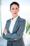Business woman staring at  the camera Stock Images