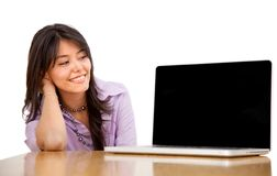 Business woman staring at a laptop Stock Photography