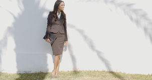 Business Woman Staying In Front Of A Wall Stock Photo