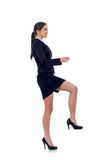 Business woman stepping on imaginary step Stock Photography