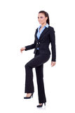 Business woman stepping on imaginary step Royalty Free Stock Photo