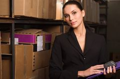 Business woman stock counting in warehouse Royalty Free Stock Photos