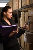 Business woman stock counting in warehouse Stock Images