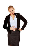 Business woman with stomach ache Royalty Free Stock Images