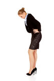 Business woman with stomach ache Royalty Free Stock Photos