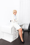 Business woman stomach ache sitting office desk Royalty Free Stock Images