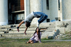 Business woman and street dancer Stock Image