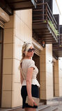 Business woman on the street in sunglasses Royalty Free Stock Photography