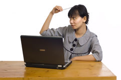 Business Woman Stress Using Laptop at the Desk. Beautiful asian business woman stress using laptop on white background Royalty Free Stock Photo
