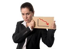 Business woman in stress wearing a suit holding a falling stats Royalty Free Stock Image