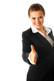 Business woman stretches out hand for handshake Stock Photos