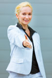 Business woman stretches out hand for handshake Royalty Free Stock Image