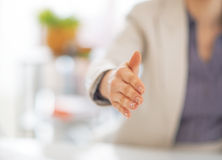 Business woman stretching hand for handshake Stock Image