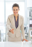 Business woman stretching hand for handshake Stock Images