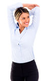 Business woman stretching her arm Stock Photography