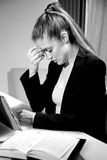 Business woman with strong headache at work in office working late Stock Photo